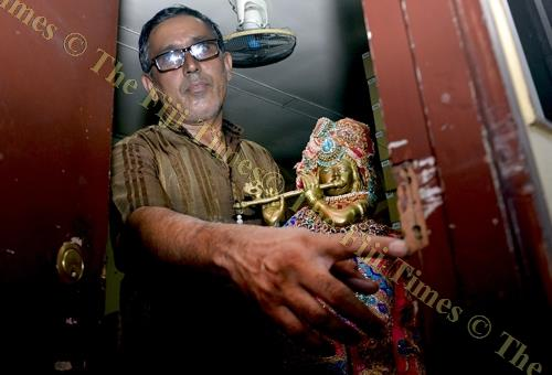 Vishnu Temple priest Hitendra Shastri shows the damage caused by the break-in. Picture: BALJEET SINGH