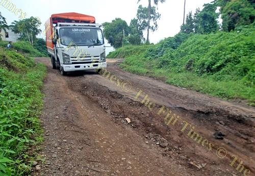 A carrier steers its way through the tough road conditons on Koro. Picture: JONA KONATACI