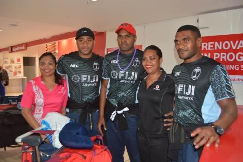 Fiji Airways 7s players Batinisavu Uluiyata, Josua Vakurunabuli and Vasikali Mudu with fans at Nadi Airport this morning. Picture: REINAL CHAND