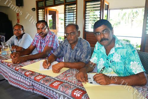 Prem Narayan (right) with farmers during the capacity building workshop for sugarcane growers co-operative executives at the Sugar Cane Growers Council hall in Lautoka yesterday. Picture: REINAL CHAND