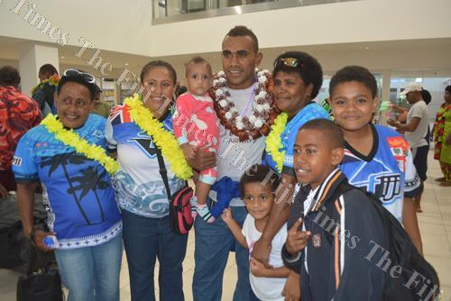 Fiji Airways Fiji 7s player Eroni Sau with his family at Nadi International Airport yesterday. Picture: REINAL CHAND