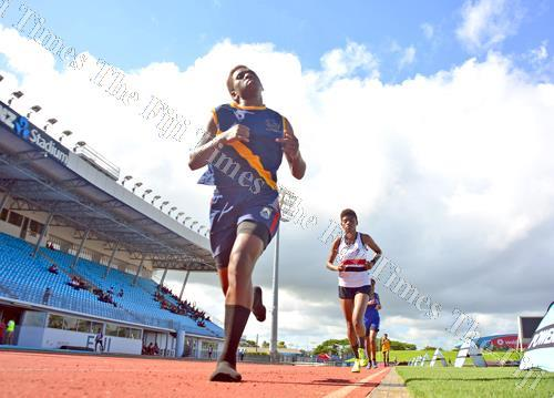 Merelita Cawai of Wainimala Secondary School outpaces Nanise Vakacegu of Adi Cakobau School and the other runners to win the girls open grade 3000m event during the Triple N Zone at the ANZ Stadium in Suva yesterday. Picture: JONACANI LALAKOBAU