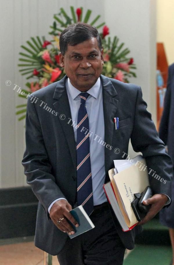National Federation Party leader and Opposition MP Professor Biman Prasad outside Parliament yesterday. Picture: JONA KONATACI