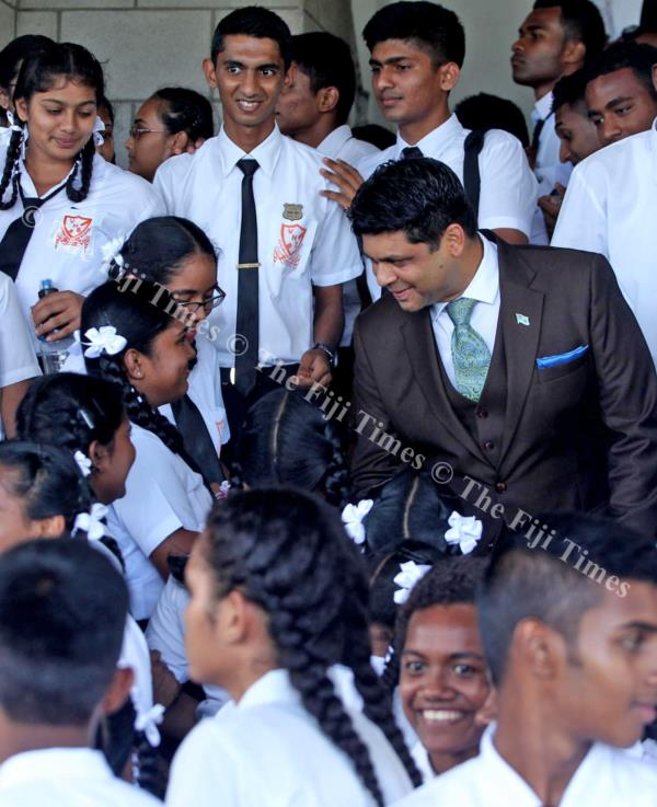 Attorney-General Aiyaz Sayed-Khaiyum meets students of Vunimono High School during a break in Parliament sitting yesterday. Picture: JONA KONATACI