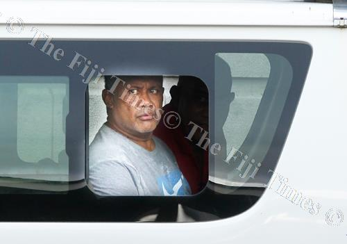 Suspect Samuela Waqa inside a police van on his way to the Remand Centre after he appeared in the Suva Magistrates Court yesterday. Picture: ATU RASEA