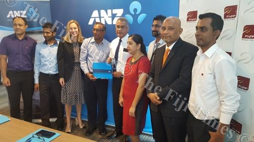 ANZ Bank and Fiji National Provident Fund staff members yesterday after announcing a three-year extension of their partnership to drive a savings culture in Fiji through the delivery of MoneyMinded financial literacy program. Picture: ELIKI NUKUTABU
