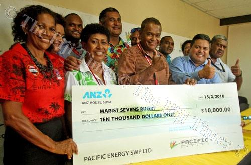 Marist Rugby Club president Lawrence Tikaram, 3rd from left, Pacific Energy business executive Tapuaki Finauga and Anare Wailevu with officials of Marist Rugby 7s after the cheque presentation yesterday. Picture: JONA KONATACI