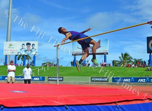 I believe I can fly... Ratu Ilisoni Naiteqe of Dilkusha High School clears the bar to win the intermediate boys high jump event. Picture: JONACANI LALAKOBAU