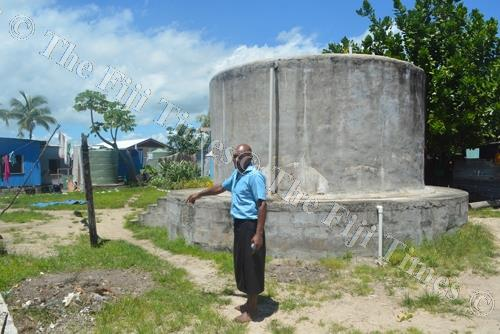 Ponipate Qio shows the empty water tanks in Vio Village Lautoka. Picture: REINAL CHAND