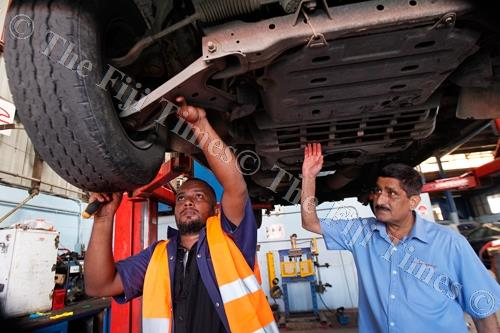 Rohit Ravisen Chand, authorised motor vehicle inspector, with Champak Patel, managing director of Eskay Motors, one of the recipients of the LTA vehicle inspection agencies. Picture: ATU RASEA