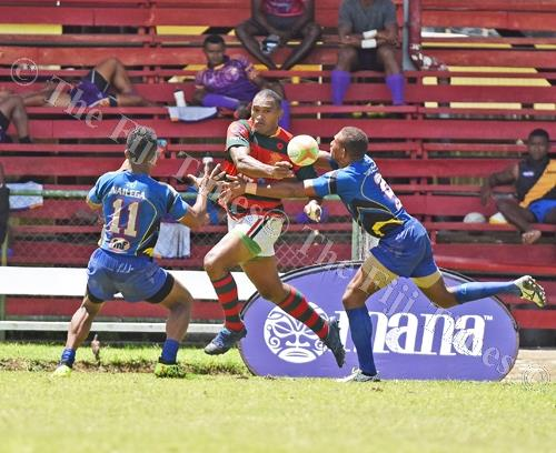 Isake Katonibau of Army Green looks for support against Tabadamu during the Uluinakau7s at Ratu Cakobau Park yesterday. Picture: RAMA