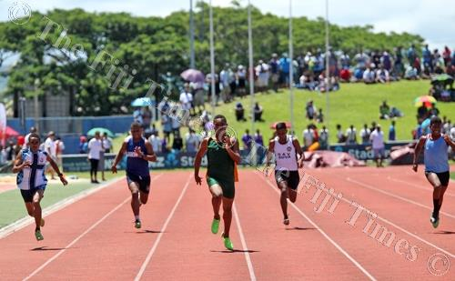 Manoa Rinakama (middle) of RSMS, leads this intermediate boys 200 metres heats at the Suva Zone I meet at the ANZ Stadium yesterday. Picture: ELIKI NUKUTABU