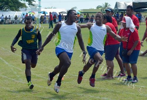 Ilaisa Bete (middle) of Ra High School celebrates his senior boys100m finals win with Aporosa Kaivata during the Tavua, Ra, Nadarivatu, Vatukoula zone meet at Garvey Park in Tavua. Picture: BALJEET SINGH