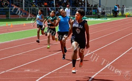 Khalsa College athlete Suluweti Kavu (front) wins the senior girls 100m final during the Ba Zone at Churchill Park in Lautoka yesterday. Picture: BALJEET SINGH