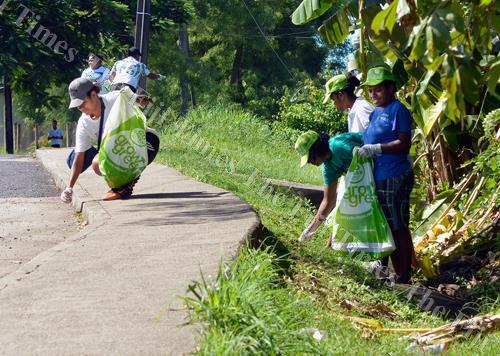 Students of FNU Lautoka campus during a clean-up campaign at Natabua, Lautoka yesterday. Picture: BALJEET SINGH