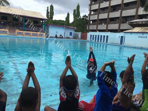 Local instructor Caroline Puamau with children at the Olympic Pool in Suva. Picture: ANA MADIGINIBULI