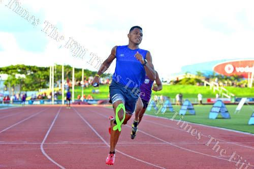 Lelean Memorial School's Eroni Vosanibola leads his team in the senior boys 4x100m relay final during the Triple N Zone at the ANZ Stadium in Suva on Thursday. Picture: JONACANI LALAKOBAU