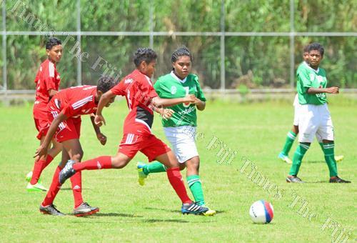 Rewa's Alisi Biu, third from left, battles for possession against Tailevu North during the Vodafone U18 Girls League at the Fiji FA Academy ground at Vatuwaqa, Suva, yesterday. Picture: JONACANI LALAKOBAU