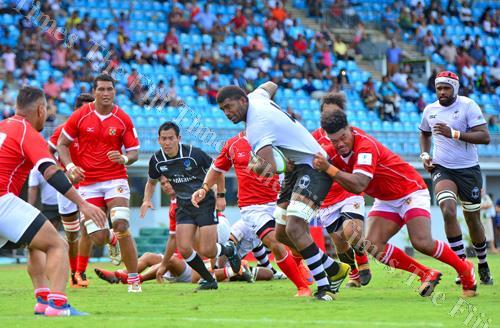 Fiji Warriors' inside centre Waisale Urabuta barges his way through the Tonga A defence to score a try during their World Rugby Pacific Challenge match at the ANZ Stadium in Suva yesterday. Fiji Warriors won the game 57-7. Picture: JONACANI LALAKOBAU