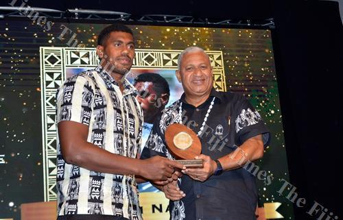 Kalione Nasoko receives the 7s male player of the year award from the Prime Minister, Voreqe Bainimarama, at the FRU awards night at Sheraton Fiji Resort & Spa, Denarau in Nadi. Picture: BALJEET SINGH