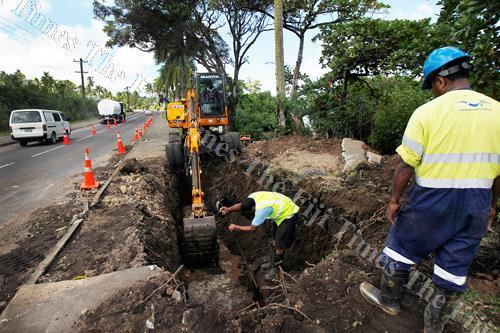 Water Authority of Fiji workers work on the damaged main pipeline along the Queens Rd in Vugalei, Lami yesterday. Picture: ATU RASEA