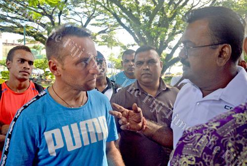 Majesty Boxing Promotion promoter Sudesh Kumar speaks with boxer Sivan Hermez at Sukuna Park in Suva on Friday. Picture: PAULINI RATULAILAI