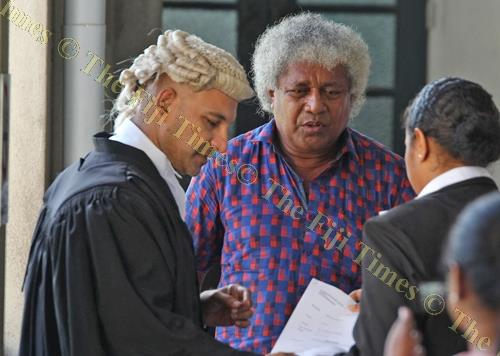 Lawyer Aman Ravindra Singh with his client Josaia Waqabaca outside the High Court in Suva yesterday. Picture: JONA KONATACI
