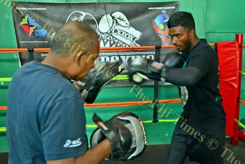 Boxer, Sebastian Singh works with trainer Gyan Singh at the Uptown Boxing gym in Samabula. Picture: JONACANI LALAKOBAU