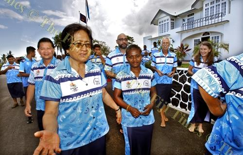 First Lady Sarote Konrote, left, converses with young weight-lifter Seruwaia Malani after Team Fiji's itatau and official photo shoot with the President and officials at Borron House in Suva yesterday. Picture: ELIKI NUKUTABU