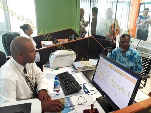 LTA staff member Sevuloni Waituruturu serves a customer at their new office in Savusavu yesterday. Picture: LUISA QIOLEVU