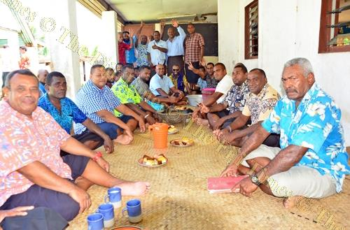 Men socialise around a tanoa of kava. Picture: JONACANI LALAKOBAU