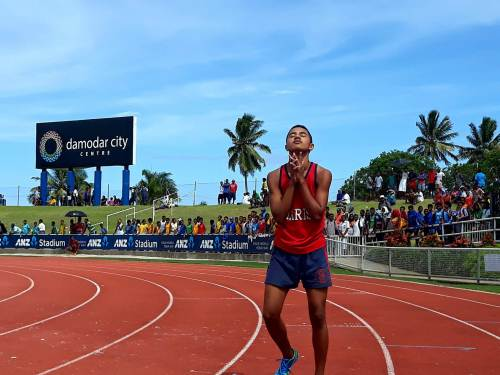 Marist athlete John Riccardo celebrates with a prayer after wining the 400m sub junior grade gold at todays Suva Zone II meet. Picture: Alisi Vucago