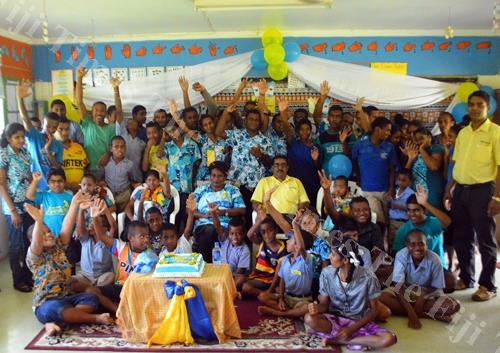 Students at the Labasa Special School with staff and members of the the FNCDP in the North during World Down syndrome day celebrations yesterday. Picture: LUKE RAWALAI