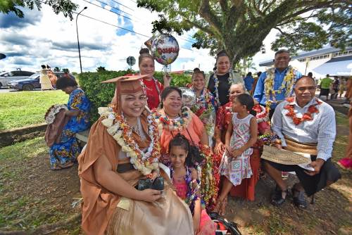 Mokaleini Fifita (left) of Tonga relaxing with the family after her graduation from University of the South Pacific at FMF Gymnasium today. Picture: RAMA