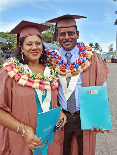 Graduating couple ... Riteshni and Sanjay Naidu after receiving their Masters in Education from the University of the South Pacific at FMF Gymnasium today. Picture: RAMA