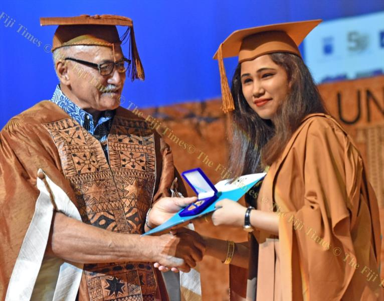Jeshika Solanki receives gold medal from the USP chancellor and the President of Fiji, Jioji Konrote, during the 2018 Medals and Prizes Ceremony graduation at Japan Pacific ICT multipurpose theatre on Tuesday night. Picture: RAMA