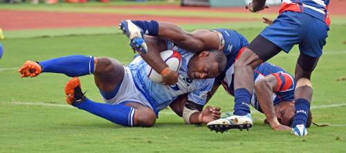 Action from Day 1 ... Inoke Tuisese of Police White brought down by the Skaffworks players during the 42nd Fiji Bitter Marist Sevens at ANZ Stadium today. Picture: RAMA