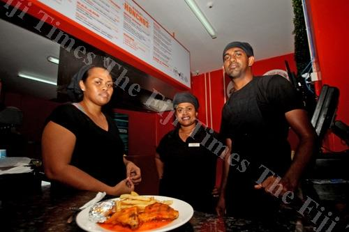 Staff members of Hungry Honchos Nakasi (from left) Kelera Vakalala, Esita Lagilagi and Nitesh Pillay ready to serve customers. Picture: JONA KONATACI