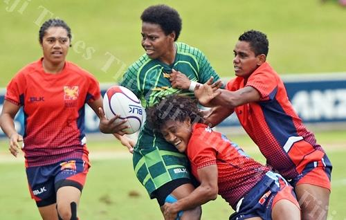 Raijieli Daveua of Wardens is stopped by the Marist Seahawks 1 defence during the 42nd Fiji Bitter Marist 7s at ANZ Stadium yesterday. Picture: RAMA