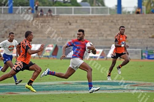 Nemani Raturuma of Marist runs away from the Muaniwavu Qauia team at the 42nd Fiji Bitter Marist 7s at the ANZ Stadium yesterday. Picture: RAMA