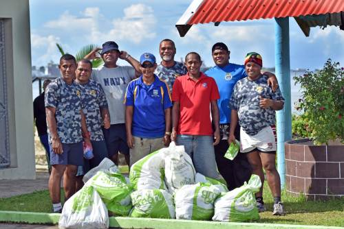 Volunteers from various organisations took the opportunity to collect rubbish and plant mangroves in a bid to save and protect the environment. Pictured is Navy volunteers with rubbish they collected. Picture: RAMA