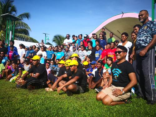 The crowd at this morning's Earth Hour beach clean-up. Picture: LICE MOVONO