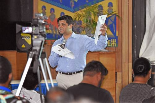 Attorney General and Minister for Economy Aiyaz Sayed-Khaiyum shows the documents to member of the public at today's national budget consultation in Suva. Picture: RAMA