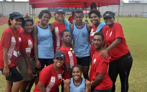 Ratu Navula College 200m senior boys and girls champions Merewalesi Marama and Emosi Taginamakadre with officials during the Nadi Zone at Churchill Park in Lautoka. Picture: BALJEET SINGH