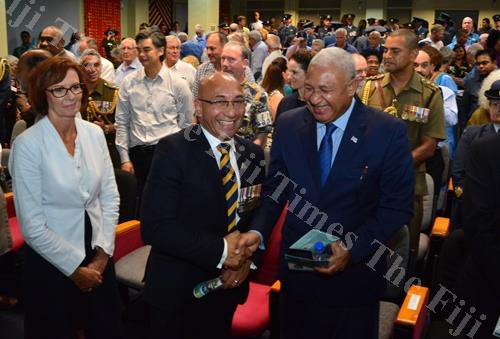New Zealand Minister for Defense Ron Mark shares a light moment with the Prime Minister of Fiji, Voreqe Bainimarama, after the official unveilING of the RNZAF commemorative monument at USP on Friday. Picture: JOVESA NAISUA