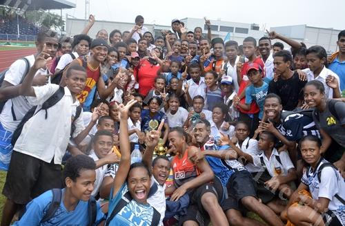 Students of Ratu Navula College celebrate after being declared the overall boys winner during the Coca-Cola Nadi Athletics Zone at Churchill Park in Lautoka yesterday. Picture: BALJEET SINGH