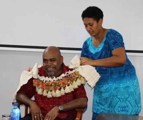 Fiji Parliament's former manager Research, Science, Technology and Environment Nikotimo Rasei is being garlanded by Parliament staff Tirisiane Logavatu at his farewell. Picture: SUPPLIED