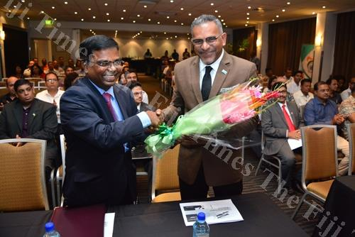 Indias High Commissioner to Fiji Vishvas Sapkal prssenting the Minister for Minister for Industry, Trade, Tourism, Lands & Mineral Resources Faiyaz Koya with a bouquet of flowers durign the opening of the India Business Meet at Holiday Inn in Suva on Frid