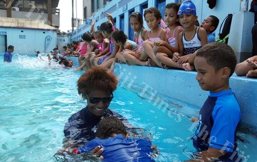 Students of Holy Trinity Anglican School enjoy World Water Day at the Suva Olympic pool. Picture: ELIKI NUKUTABU