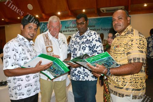 Sugar Ministry director Sanjay Kumar (left) with FSC chief executive officer Graham Clark, farmer leaders Rajnesh Naicker and Joji Nava look through the Establishing a Farmer Field School: A Handbook for Fiji's Sugar Industry after its launch in Nadi yest